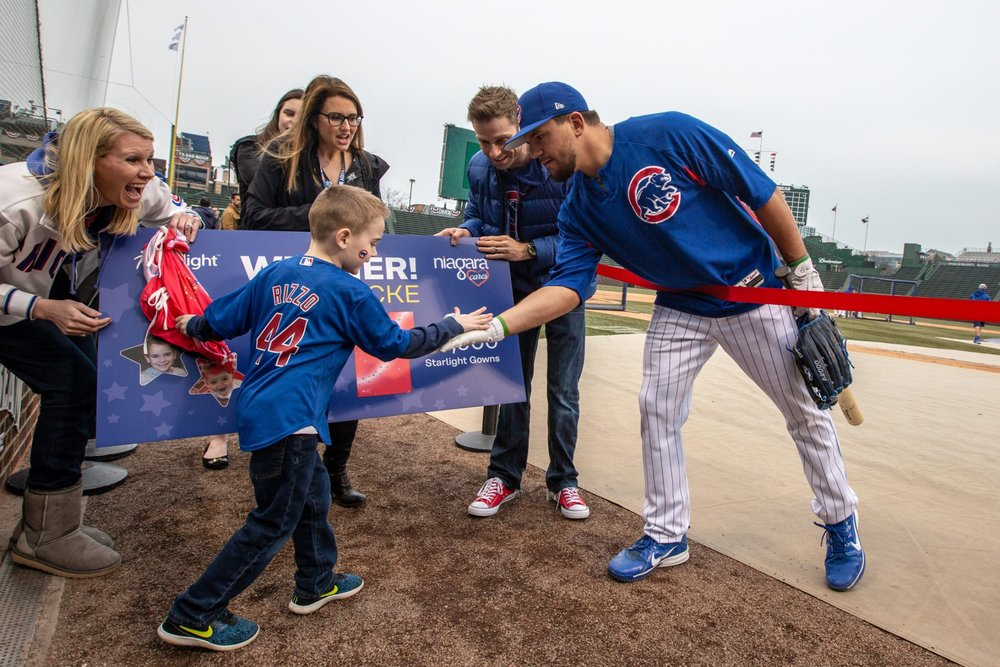 Jack throws opening pitch at Cubs game after winning Design-A-Gown contest.