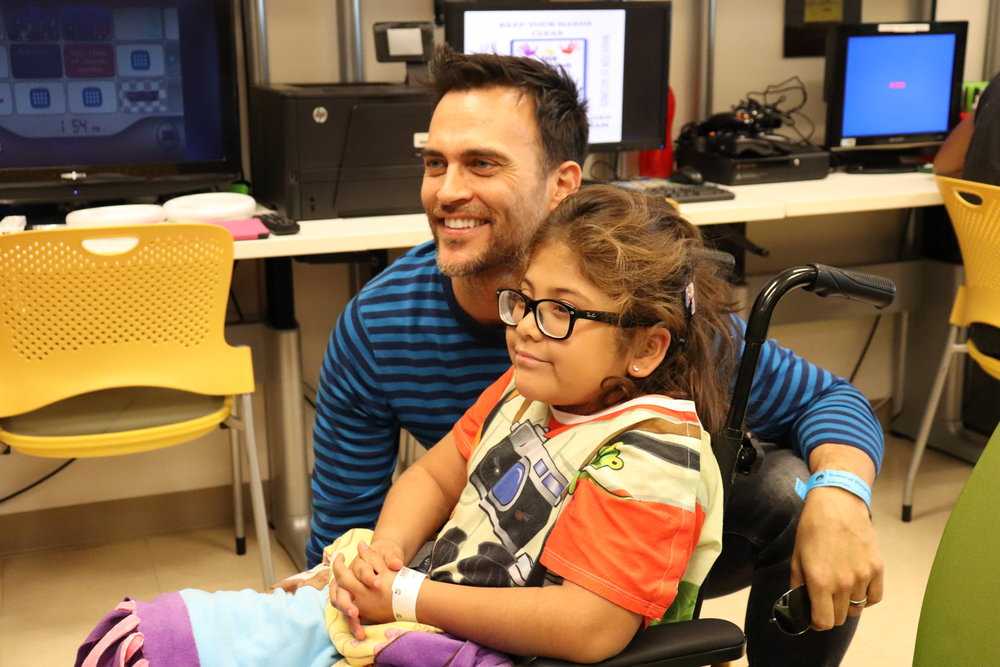 Cheyenne Jackson with a Starlight Kid