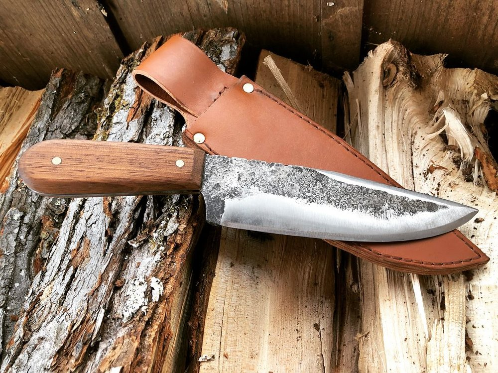Bowie knife and one of our handmade sheaths.