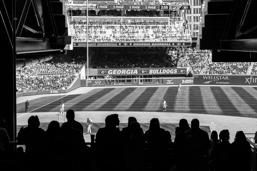 Baseball fans watch from beneath the awning during the Bulldogs' game against Missouri at SunTrust Park in Atlanta, Ga. on Saturday, April 8, 2017. (Photo by John Paul Van Wert)