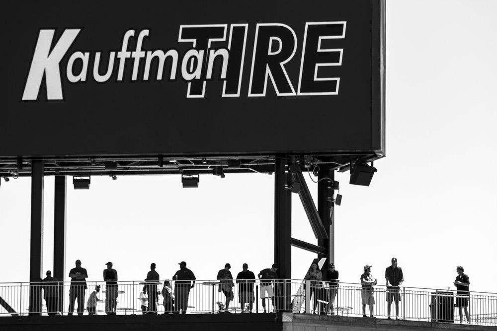 Baseball fans watch from under the Kauffman Tire sign at center field during the Bulldogs' game against Missouri at SunTrust Park in Atlanta, Ga. on Saturday, April 8, 2017. (Photo by John Paul Van Wert)