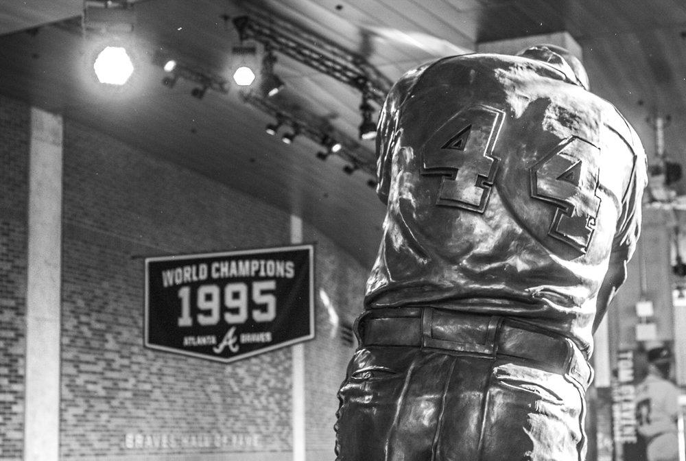 The Hank Aaron statue in the Atlanta Braves baseball museum during the Bulldogs' game against Georgia Tech at SunTrust Park in Atlanta, Ga. on Tuesday, May 9, 2017. (Photo by John Paul Van Wert)
