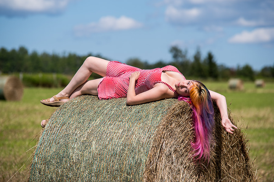 Kim relaxing on a bail of hay.