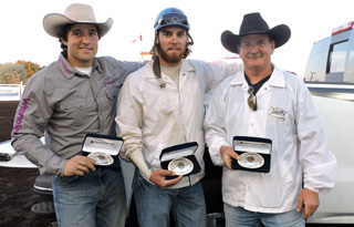 2015 Medicine Hat Exhibition & Stampede Champions Adver-Team Chuckwagon Outfit (L-R) Outriders Dustin Gorst, Chance Flad, Driver John Walters Photo By D'Arci Larson