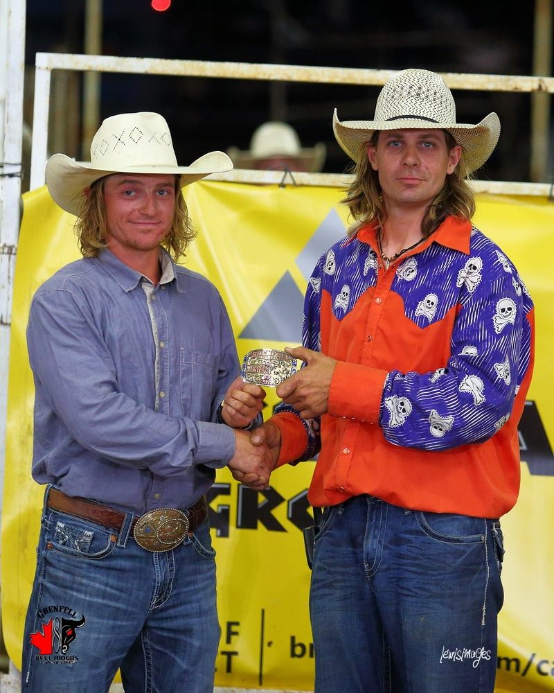 Kory Ginnis presents Flint Vayro with the buckle for winning Saturday's Grenfell, SK Bull-A-Rama. Photo by Randy Lewis