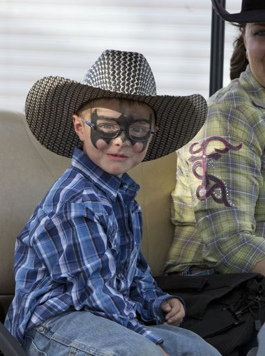 Six-year-old Owen, from Washoe Valley, disguised as Batman during the Reno Rodeo on Saturday, June 20, 2015. (Photo: Tom R. Smedes/Special to the RGJ, Tom R. Smedes/Special to the RGJ)