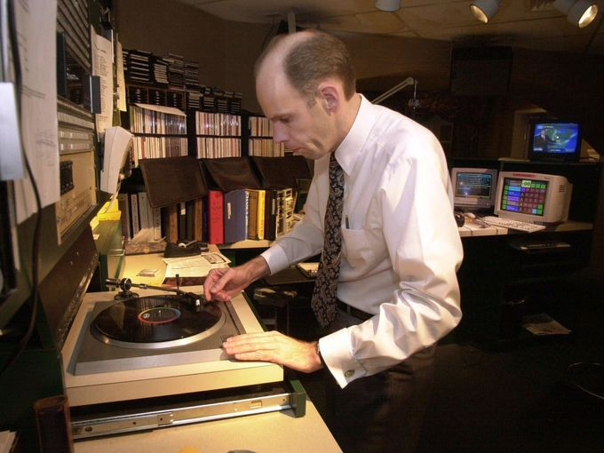 Eddie Stubbs puts an album on the turntable during his show Oct. 3, 2000, at the WSM-AM studio. At WSM, which celebrates its 75th anniversary this month, it's not unusual to hear a mountain classic by an old-timer after a hit by Garth Brooks. And it's not unusual for a disc jockey to reach for a vinyl album along with a CD.(Photo: Mark Humphrey / AP Photo)