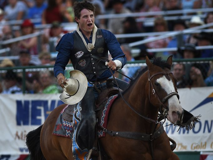 Trenton Montero, from Winnemucca, takes a victory lap after winning the bareback bronc riding event during the Reno Rodeo on June 24, 2015.   Jason Bean, Jason Bean/RGJ