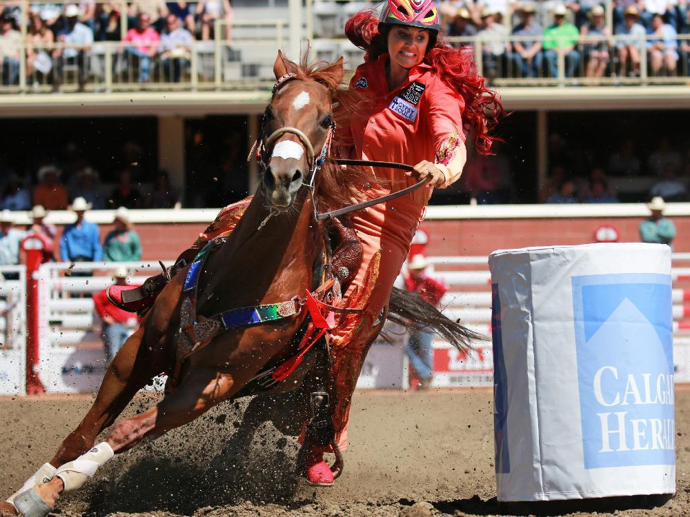 Fallon Taylor from Collinsville Texas competes in the barrel racing event during day 1 of the Calgary Stampede rodeo on Friday July 3, 2015.