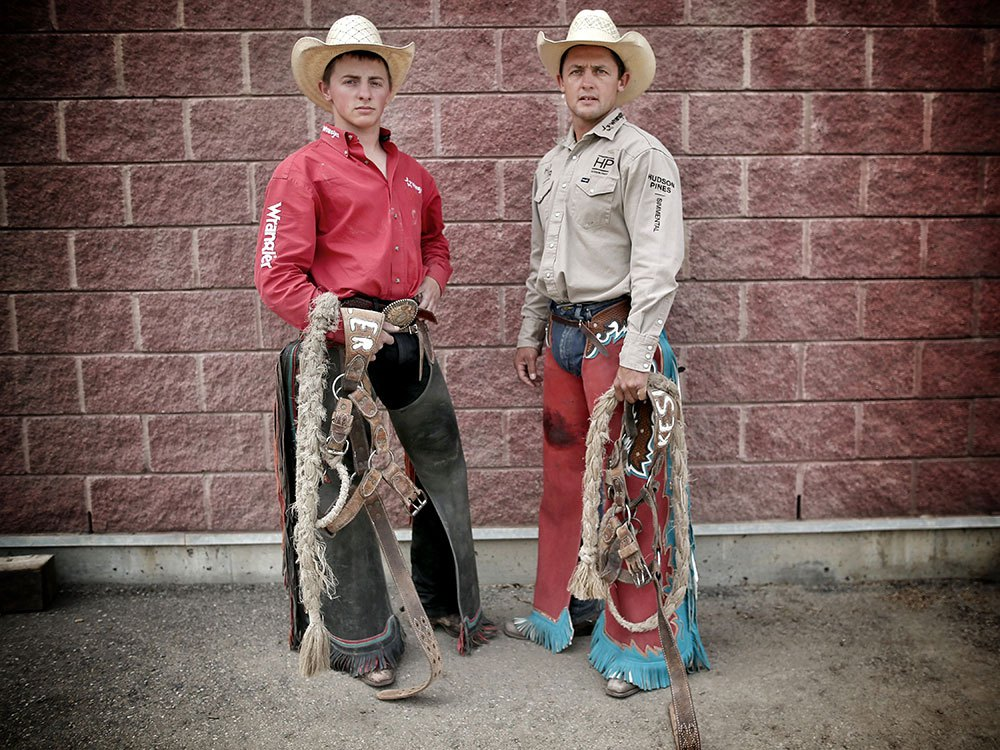 Rusty,19, left, and his dad Cody Wright are both competing in the saddle bronc competition at the Calgary Stampede. LEAH HENNEL /  CALGARY HERALD