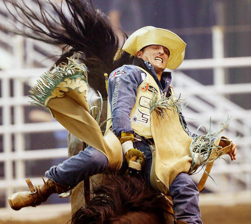 Will Lowe of Canyon Texas, does his best to hold onto Holly Time, as he rides in the final night of competition Saturday, July 25, 2015, of the Days of 47 Rodeo at EnergySolutions Arena in Salt Lake City. (Scott G Winterton, Deseret News)