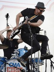 """Kristian Bush performs at the Riverfront stage during the CMA Music Festival on June 13 in Nashville. Bush recently released his debut solo album, """"Southern Gravity.""""(Photo: Mark Zaleski / For The Tennessean)"""