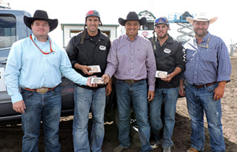 2015 Bonnyville Chuckwagon Championship Champions George Normand Memorial Buckle Winners SITE Energy Services Outfit (L-R): B.J. Normand Presenting,Outrider Quaid Tournier, Driver Luke Tournier, Outrider Chance Flad, BPRCA President Mitch Michaud Presenting