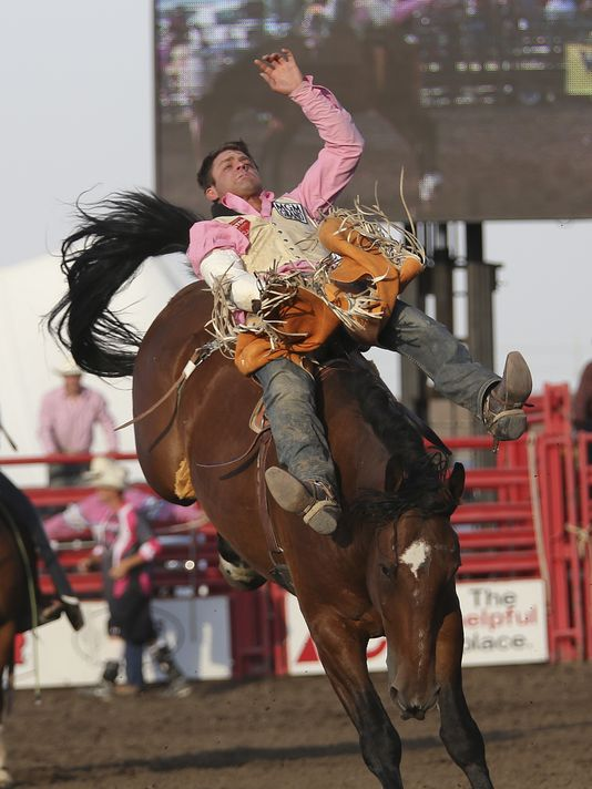 "Casey Colletti of Pueblo, Colo., scores an 82 on the bareback horse ""Lone Ranger"" Thursday at the Big Sky Pro Rodeo Roundup.(Photo: TRIBUNE PHOTO/KYLIE RICHTER)"