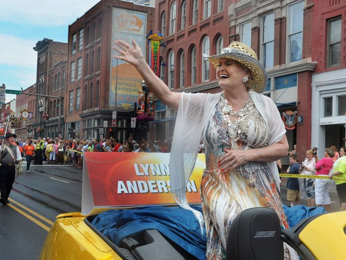 Country star Lynn Anderson waves to the crowd during the CMA Music Festival Kick-Off Parade on June 5, 2013, in downtown Nashville.