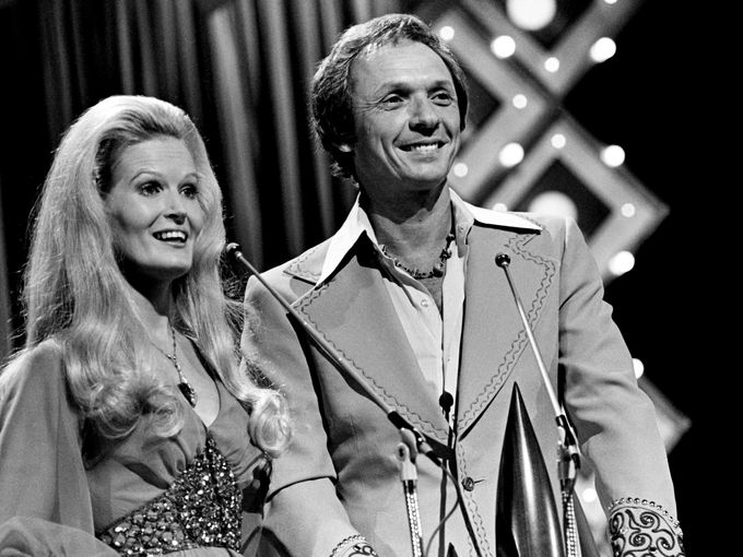 "Presenters Lynn Anderson and Mel Tillis name Ronnie Milsap as winner of Album of the Year for ""A Legend in My Time"" at the nationally televised CMA Awards show Oct. 13, 1975, at the Grand Ole Opry House."
