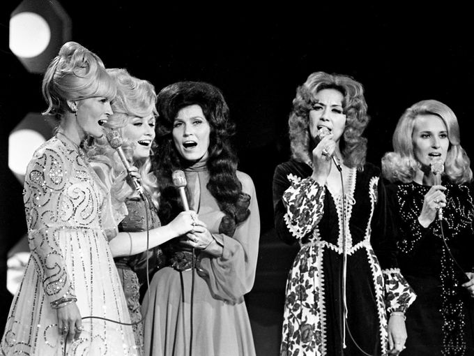"Lynn Anderson, left, Dolly Parton, Loretta Lynn, Dottie West and Tammy Wynette sing a medley around a ""country girl"" theme during the sixth annual CMA Awards show Oct. 16, 1972.  Frank Empson / The Tennessean"