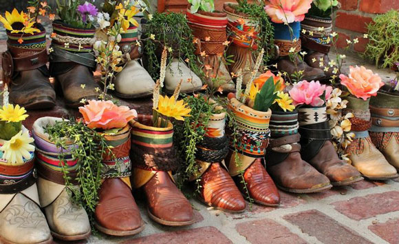 This collection of boots and flowers is stunning! Remember sometimes a collection of things leaves a big impact.  Photo source: Bohemian Shoebox >