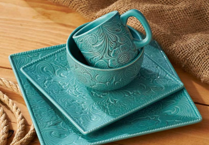 The Prairie Garden dinnerware collection features solid turquoise and replicates the look of floral tooled leather. I love that the plates are square and not round. Purchase the set from Wild Wings >