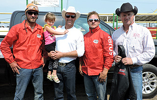 2015 Strathmore Heritage Days Stampede Champions Rob Knight Trucklines Outfit (L-R): Outrider Chad Cosgrave, Steele Glass,Driver Jason Glass, Outrider Chanse Vigen, WPCA General Manager Tom Barrow Presenting Photo By Billy Melville