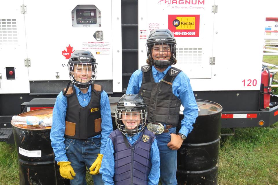 Future wagon drivers and outriders Cruise Bensmiller, Weston Sutherland and Britton Irvine getting ready to compete in the Wild Pony Race