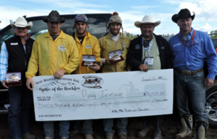 2015 Battle of the Rockies Champions B & R Eckel's Transport Ltd. Outfit (L-R): TOMCO Group of Companies Rod Tomyn Presenting, Driver Doug Irvine, Outriders Chance Flad & Rory Gervais Rocky Mountain Chuckwagon Association's Brad Smith and WPCA' General Manager Tom Barrow Presenting Photo By Billy Melville