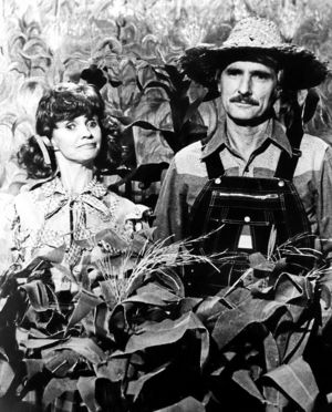 "Almost anyone was a candidate to pop up in the cornfield of ""Hee Haw."" In this photo, cast member Roni Stoneman is joined by Dennis Weaver."