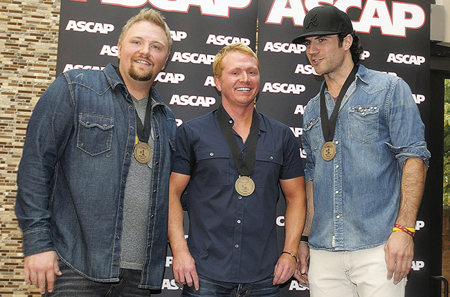 Josh Osborne, Shane McAnally and Sam Hunt at ASCAP #1 Party at the CMA Building on August 21, 2012 in Nashville.Beth Gwinn/Getty Images