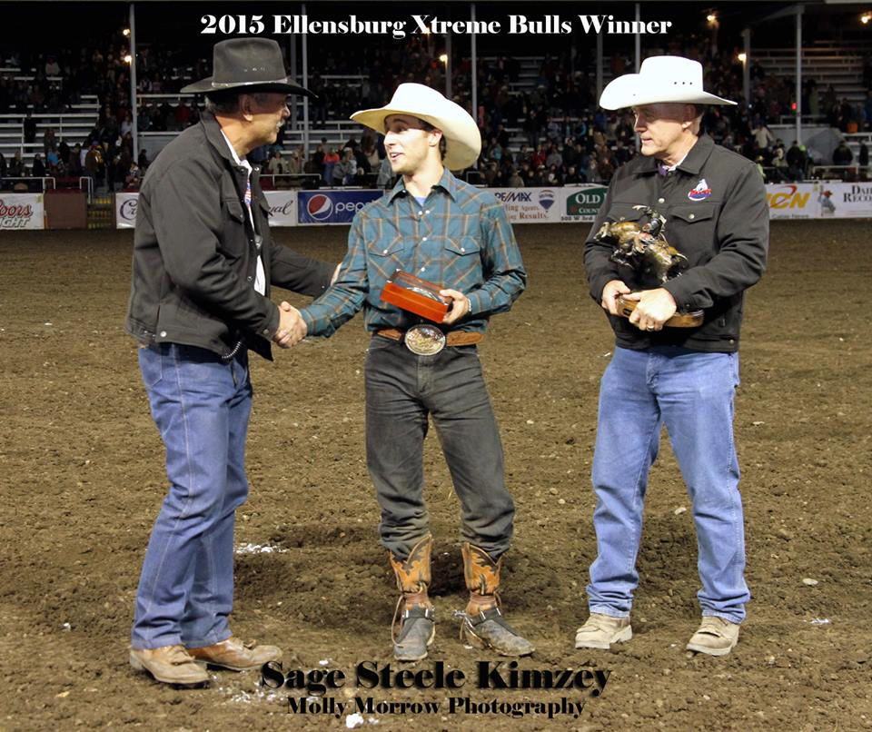 Congratulations to PRCA Bull Rider, Sage Steele Kimzey from Strong City, OK on his win of the 2015 Ellensburg Xtreme Bulls Tour Finale. Kimzey rode Flying 5's #191 in the first round for a score of 85 and went on to clinch the win in the short go with an 85.5. Kimzey is shown here receiving his awards from Xtreme Bulls Rodeo Board Director, Rick Cole and Ellensburg Rodeo Board President, Gene Dana. Photo by Molly Morrow
