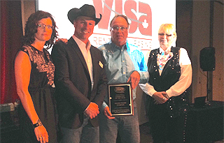 "The Grande Prairie Stompede was named the WPCA Top Race Committe of 2015. Presenting the award is General Manager Tom Barrow (second from left), to Grande Prairie Stompede Association President Terri Ellen Sudnik (far left), Dale Impey (second from right), and the original ""Stompede Sue"" Bernie Benson (far right)."