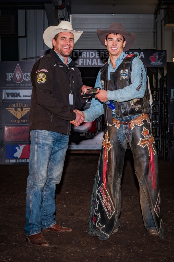 BRC Vice President Chad Pighin presents Cody Coverchuk with the finals event championship buckle in Lloydminster, SK on October 3rd, 2015. Photo by Jack Vanstone/Legendary Photoworks.