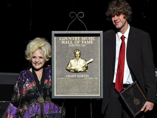Recording artist Brenda Lee and Joshua Martin (son of inductee Grady Martin) with the plaque honoring Grady Martin during The Country Music Hall of Fame 2015 Medallion Ceremony. (Photo: Rick Diamond / Getty Images)