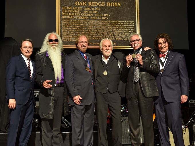 Left to right are Jody Williams, William Lee Golden, Duane Allen, Kenny Rogers, Joe Bonsall, and Richard Sterban onstage during The Country Music Hall of Fame 2015 Medallion Ceremony at Country Music Hall of Fame and Museum on October 25, 2015 in Nashville, Tennessee. John Shearer / Getty Images for CMHOF