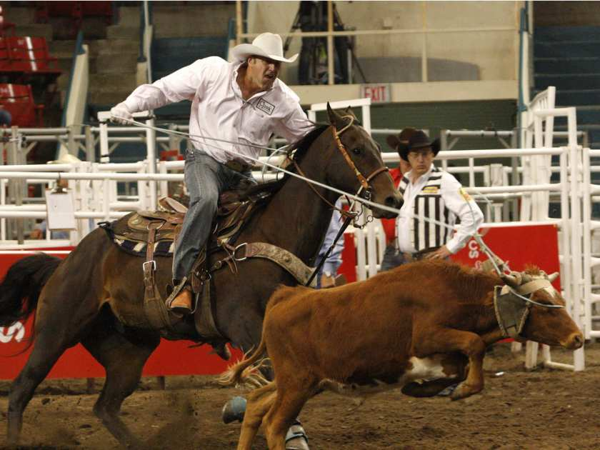 Brett Buss of Ponoka, pictured in a 2008 file photo competing in the Canadian Rodeo Tour team roping event in Calgary, will compete in the 2015 Canadian Finals Rodeo team roping event with his cousin, Klay Whyte. ADRIAN SHELLARD/JASON SCOTT / CALGARY HERALD