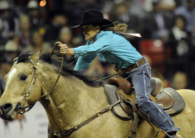 Barrel racer Lisa Lockhart from Oelrichs, S.D., rides to a sixth place time of 14.02 seconds during the tenth go-round of the National Finals Rodeo at the Thomas & Mack Center in Las Vegas, Saturday, Dec. 13, 2014. (Josh Holmberg/Las Vegas Review Journal)