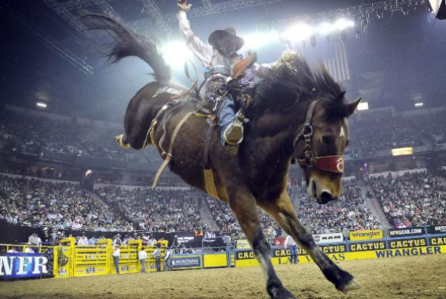 Cody Wright of Milford, Utah competes in the saddle bronc riding during the fifth go-round of the National Finals Rodeo at the Thomas & Mack Center on Monday, Dec. 8, 2014, in Las Vegas. (David Becker/Las Vegas Review-Journal)