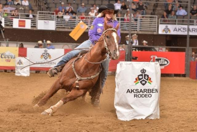 Vickie Carter, aboard Blaze, rounds a barrel while competing at a rodeo in Omaha, Neb., earlier this year. Carter, 60, in her first full season on the WPRA tour, qualified for the Wrangler National Finals Rodeo. WPRA photo by Greg Westfall.