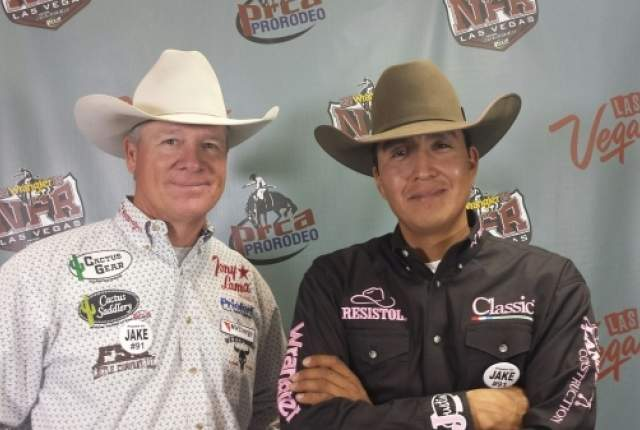 Clay O'Brien Cooper, left, and Derrick Begay, shown after tying for first in the fifth go-round of team roping at the Wrangler National Finals Rodeo on Monday night at the Thomas & Mack Center. O'Brien Cooper and Begay have three go-round wins this week and have taken the lead in the world standings. PATRICK EVERSON/LAS VEGAS REVIEW-JOURNAL