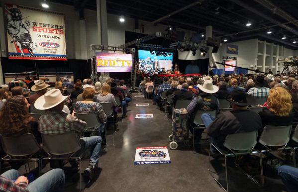 Attendees watch as Flint Rasmussen interviews rodeo legend Larry Mahan during a broadcast of Outside the Barrel on RFD-TV at the Cowboy Christmas Gift Show in the Las Vegas Convention Center, Wednesday, Dec. 9, 2015. Jerry Henkel/Las Vegas Review-Journal