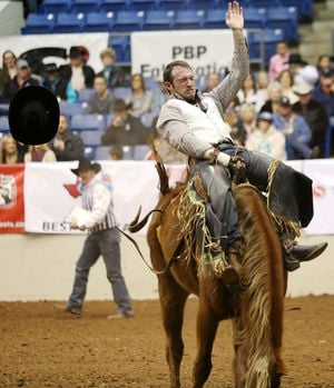Edyta Blaszczyk|Odessa American Bareback rider Matt Bright holds on to Satin Sheets for an 81 point ride during the first performance of the SandHills Stock Show and Rodeo on Friday at the Ector County Coliseum.
