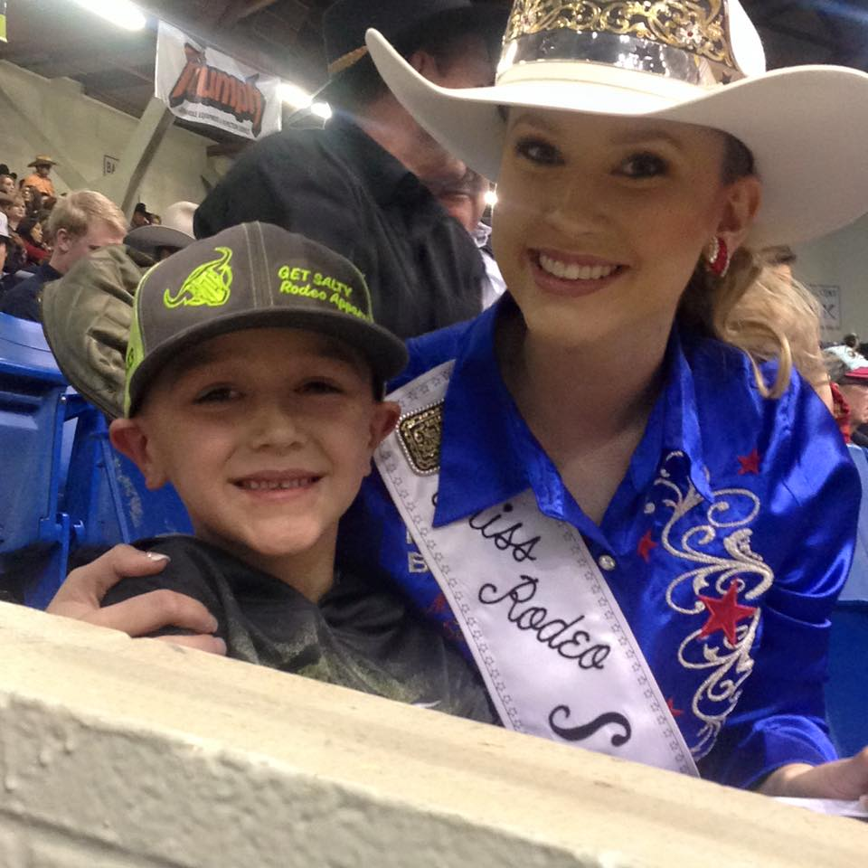 A little Get Salty cowboy gets some quality time with Miss Rodeo Sandhills.