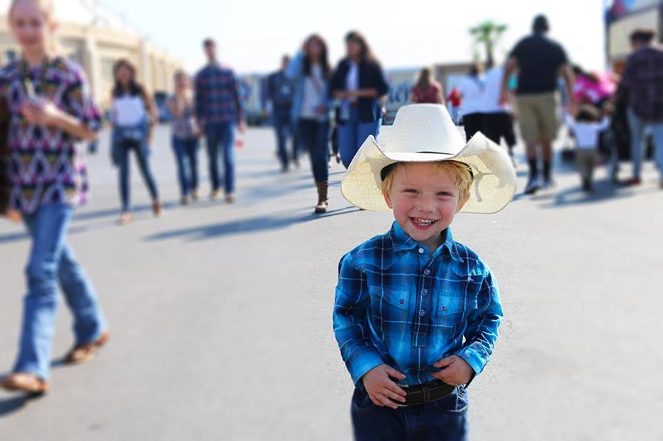 We're with you little cowboy; the Rodeo makes us happy too! LIKE this photo if Rodeo makes YOU happy!