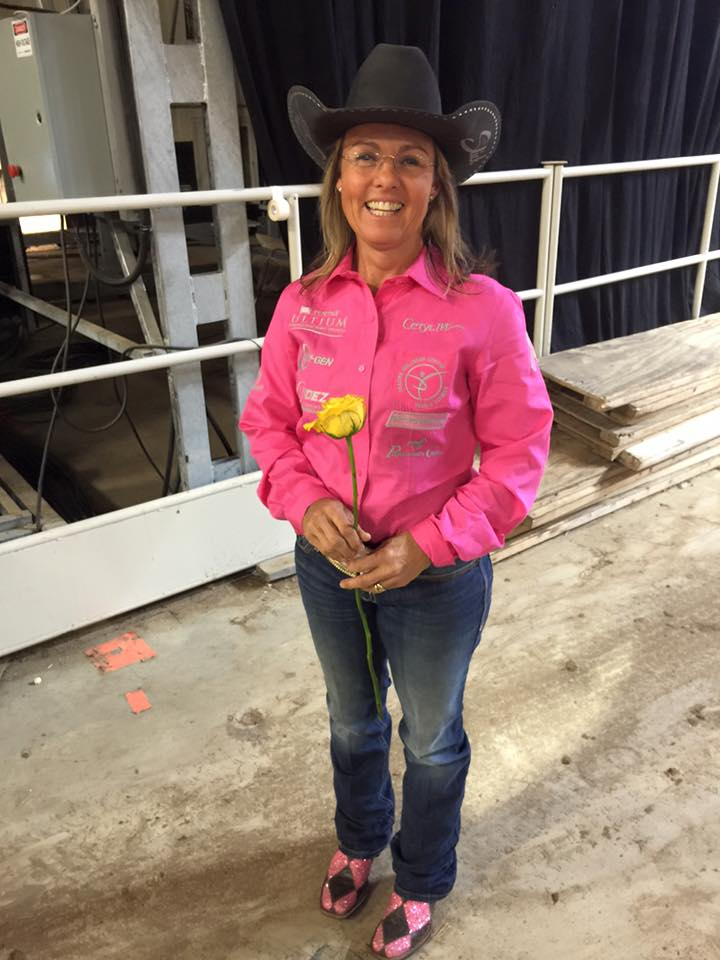 Michele McLeod won the barrel racing title with a total of $23,528, and also received a flower.