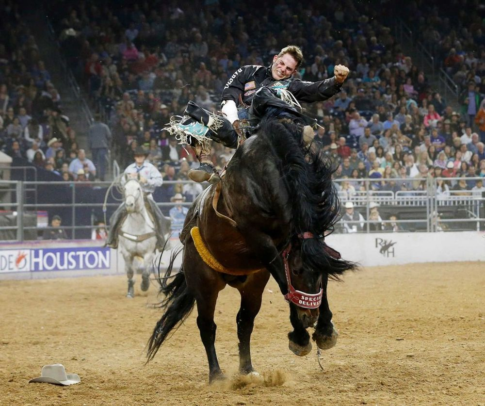 Austin Foss competes during the final of the bareback riding competition on the last day of the Houston Livestock Show and Rodeo Sunday, March 20, 2016, in Houston. Foss was the day's champion in the event. Photo: Jon Shapley, Houston Chronicle