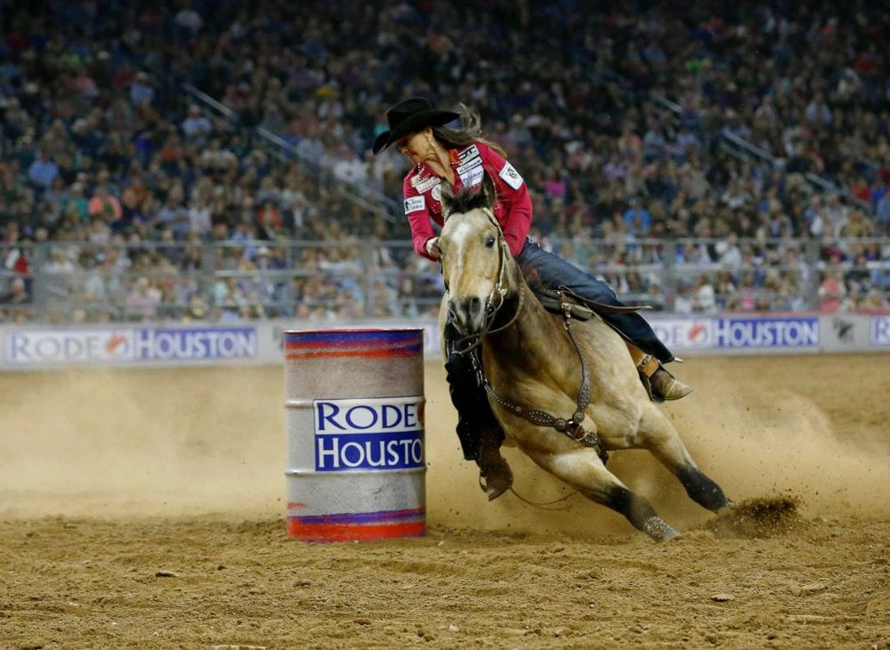 Lisa Lockhart competes during the final of the barrel racing competition on the last day of the Houston Livestock Show and Rodeo Sunday, March 20, 2016, in Houston. Lockhart won the Super Shootout: North America's Champions in the event Photo: Jon Shapley, Houston Chronicle