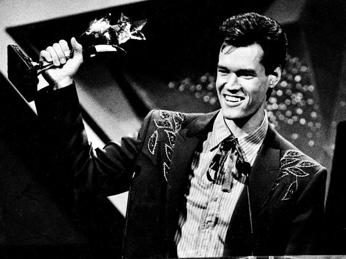 Randy Travis shows off one of the five awards he won at the TNN Viewer's Choice Awards show in Nashville April 26, 1988. Robert Johnson/The Tennessean