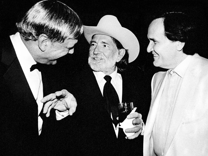 Fred Foster, left, Willie Nelson and Roger Miller talk during a reception before Nelson received an award from NARAS on June 20, 1989.  Rick Musacchio / The Tennessean