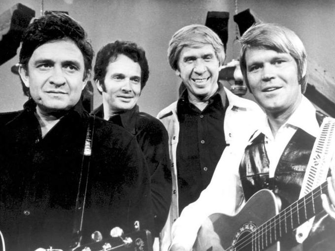 1970s (early, approximately): Glen Campbell, right, appears with, from left, Johnny Cash, Merle Haggard and Buck Owens on The Glen Campbell Goodtime Hour in this undated publicity photo.  Associated Press