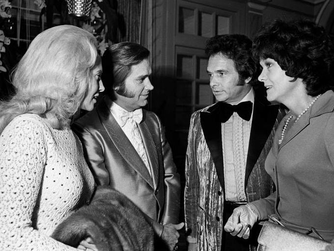 1973: Husband and wife teams take a breather as Tammy Wynette, left, and George Jones chat with Merle Haggard and Bonnie Owens during the BMI Awards banquet at the Belle Meade Country Club.  Robert Johnson / The Tennessean