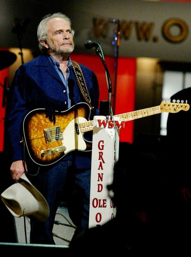 "Merle Haggard is moved by the cheering crowd after he finished a song during the ""Grand Ole Opry"" on Sept. 27, 2003.  Alan Poizner / For The Tennessean"